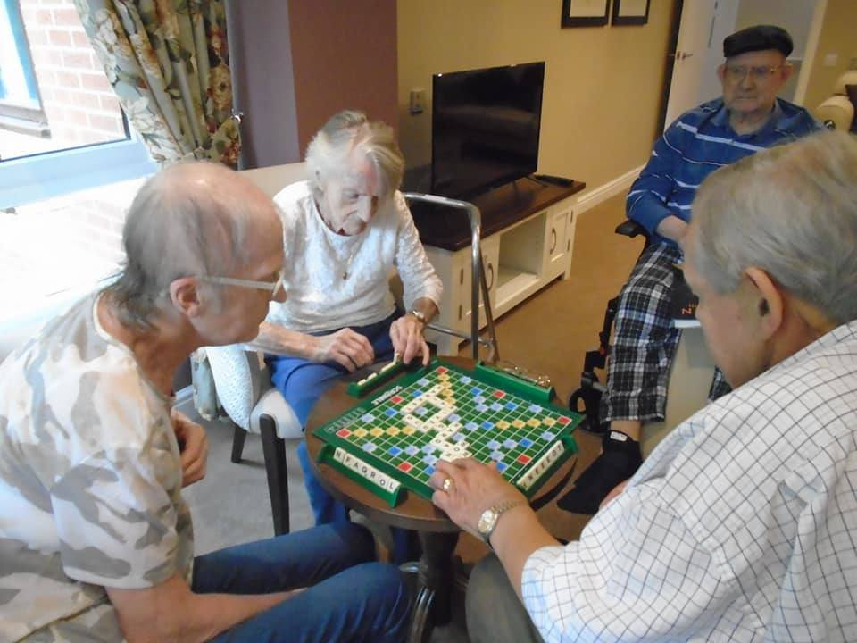 Seniors playing scrabble at Pingley Court Care Home